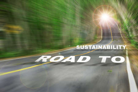 Road to sustainability word on motion blurred view of high speed road. Inspiration and motivation concept and effort idea