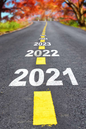 Journey to new year 2021 to 2026 on asphalt road surface with autumn season, happy new year concept