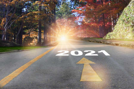 Road to 2021 with autumn season background, new year road trip concept and fall color idea