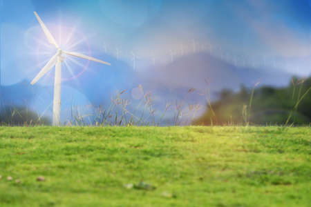 Wind turbines on mountain range background. Renewable clean energy investment for sustainability concept and alternative energy economic growth idea