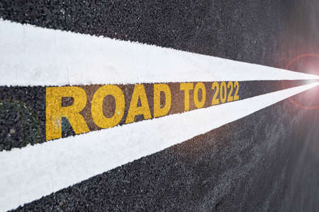 Road to 2022 word on road surface. Business challenge future ahead concept and keep moving idea