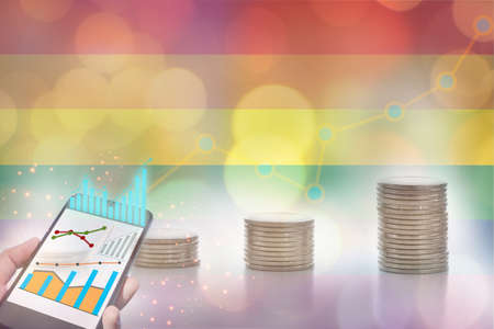 Marketing and financial technology for LGBT lesbian gay bisexual transgender and stack of coins on rainbow flag bokeh background. Making money with saving concept and return on investment roi idea Stock fotó