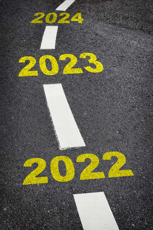 New year 2022 to 2024 on black asphalt road and white marking lines, Happy new year and road to success concept Reklamní fotografie