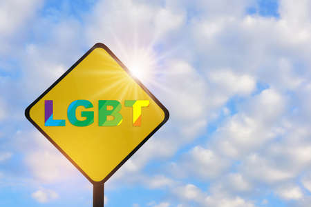 LGBT word on yellow sign on beautiful blue sky with fluffy cloud background. Lesbian gay bisexual transgender concept and equality diversity idea