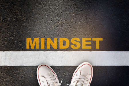 Mindset written on asphalt road surface with white starting lines. Self development to success concept and challenge idea