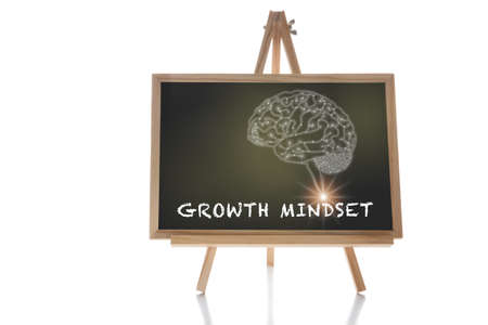 Growth mindset word and brain human drawing on chalkboard isolated on white background. Potential development concept and good attitude motivation idea