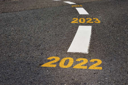 2022 to 2024 on black asphalt road and white marking lines, Happy new year and road to success concept Reklamní fotografie - 165054184