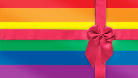 Red ribbon on rainbow flag background. LGBT Lesbian gay bisexual transgender happy pride concept and equality diversity idea Reklamní fotografie