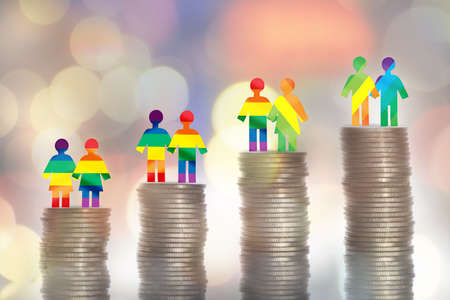 Love is love lGBT lesbian gay bisexual transgender rainbow model on stack of coins on colorful bokeh background. Making money with saving concept and return on investment roi idea Reklamní fotografie