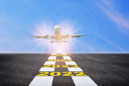 Commercial plane ready to take off with year 2022 to 2025 on the runway