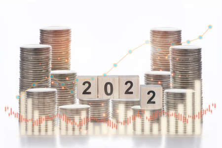 2022 on stack of coins with growth graph on white background, business success concept and growth idea with double exposure