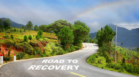 Road to recovery word on asphalt road surface with marking lines. Economic recovery  concept and business challenge idea