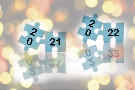 New year 2021 and 2022 on blue puzzle with reflection on abstract background, business success with challenge concept and keep trying idea Stock fotó