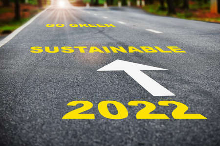 2022 sustainable go green on asphalt road surface with marking lines. Sustainable future concept and Inspiration with motivation idea Stock fotó