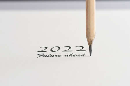2022 Future ahead word with pencil on white paper. Start to new year concept and think different idea