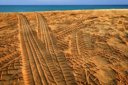 Tyre track on sand beach. Abstract concept and transportation idea Stock fotó
