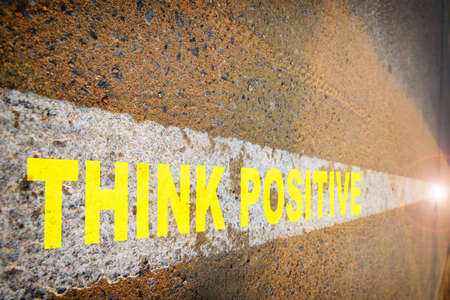 Think positive on asphalt road with sand and white marking line. Business challenge concept and success idea Stock fotó