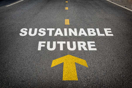 Sustainable future word and yellow arrow on asphalt road with marking lines for separate lane. Inspiration and motivation concept and effort idea