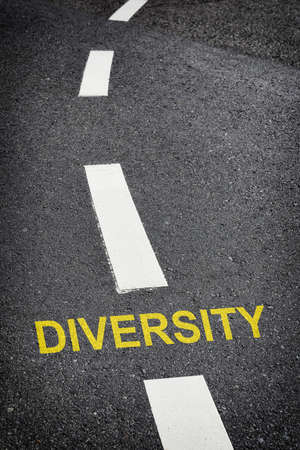 Opportunity and decision empathy concept and success with direction idea. Diversity word written on road background Reklamní fotografie