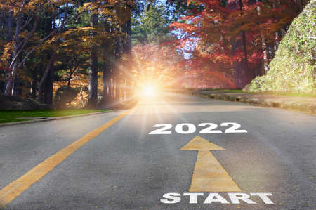 Start to 2022 with arrow and sunlight on autumn season background, Happy new year road trip concept and business beginning challenge idea Reklamní fotografie