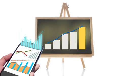 Online financial technology or fintech on smartphone and financial growth graph stock trading on chalkboard isolated on white background. Economic recovery concept and education making money idea