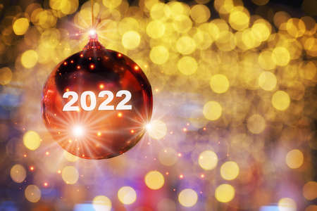 New year 2022 reflection on red ball on yellow abstract bokeh blurred background, Happiness holiday concept and decoration idea Reklamní fotografie