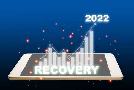 New year recovery to 2022 with growth graph on digital tablet computer on abstract background. Business future ahead concept and technology transformation investment idea