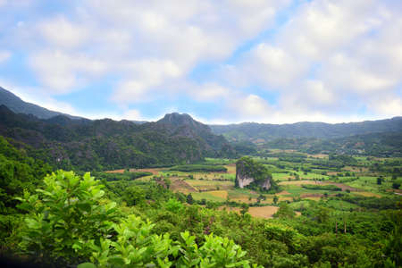 Beautiful rural countryside and mountains landscape with cloudy blue sky background in Phayao province, Thailand. Travel Thailand concept and nature idea