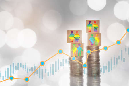 LGBT lesbian gay bisexual transgender rainbow model on wooden cube on stack of coins on growth graph bokeh background. Making money with saving concept and trading return on investment roi idea