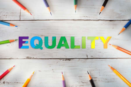 Colorful equality word with colored pencil on wooden background. Lesbian gay bisexual transgender LGBTQ concept and diversity lifestyle freedom idea