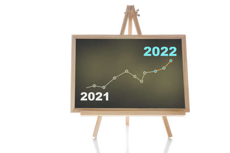 2021 to 2022 financial growth graph stock trading on chalkboard isolated on white background. Return on investment roi concept and education making money idea