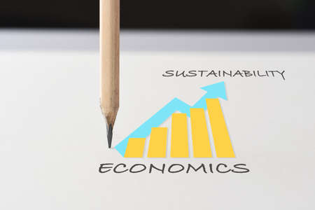 Drawing sustainable business strategy concept and future ahead idea. Economics growth graph written on white paper with pencil