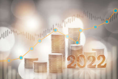 2022 with stack of coins and growth graph on bokeh background. Sustainable business with return on investment concept and economic growth idea Standard-Bild