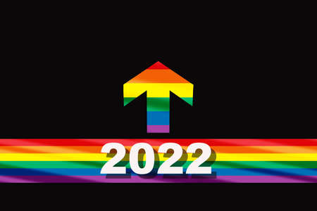 New year 2022 on colorful rainbow flag starting line and arrow on black background. Diversity freedom concept and equality social issue idea