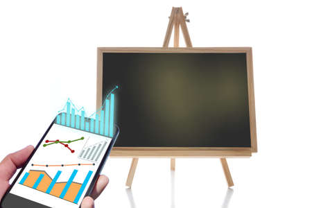 Online financial technology or fintech on smartphone and blank chalkboard isolated on white background. Economic recovery concept and education making money idea