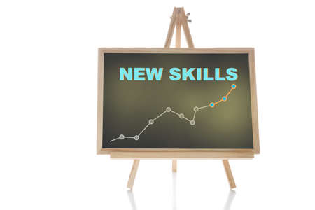 New skills and growth graph written on chalkboard isolated on white background. Education planning improvement concept and reskilling and upskilling idea Standard-Bild