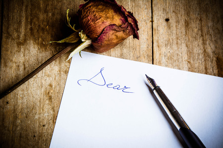 Writing a letter to an old forgotten love.