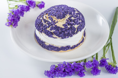 shu: blueberry cake shu decorated with purple flowers of statice