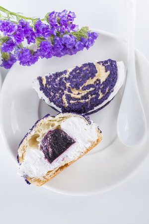 shu: blueberry cake shu decorated with purple flowers of statice, view from above