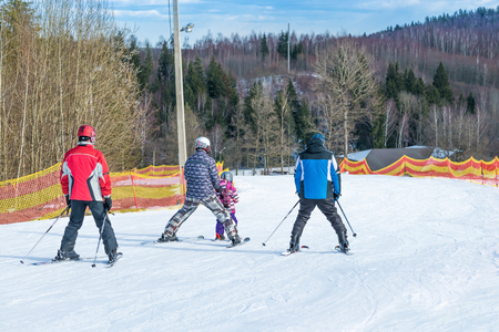 kids at the ski lift: child learning to ski