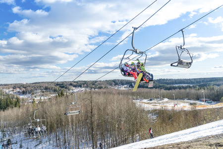 skiers: skiers ride the ski chair lift up Stock Photo