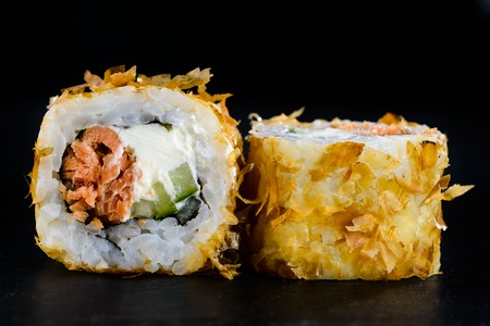 Delicious tasty sushi roll with cucumber, salmon and cream chees