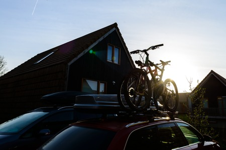 Bike transportation, bikes on cars roof Archivio Fotografico