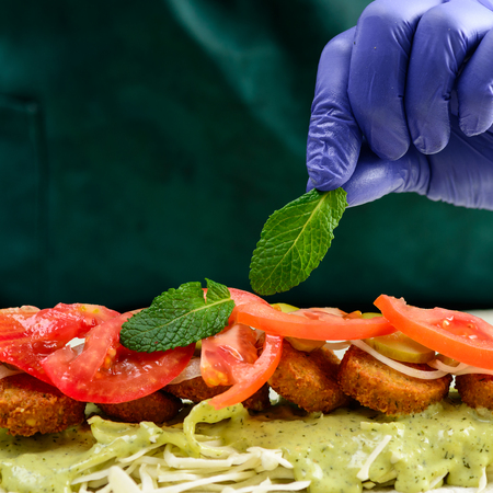Process of preparing appetizing roll with falafel, vegetables an