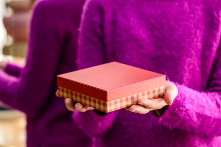 Unidentified woman holding a gift. Concept of celebration holida Stock Photo