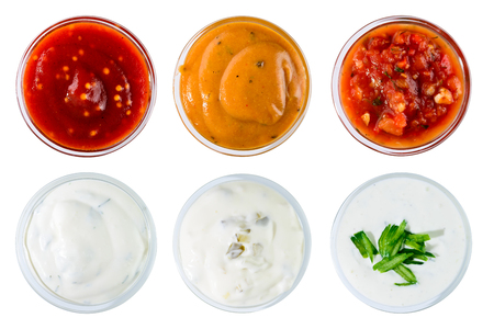 Set of different delicious sauces for dishes isolated on white b Stock Photo