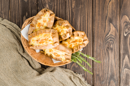 classical Italian fresh homemade Karelian pies with potato, carr Banque d'images - 104610447