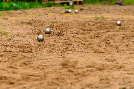 metal balls for petanque game on sand Stock Photo