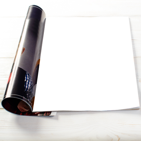 close-up of open magazine with blank white pages on light wooden Stock Photo