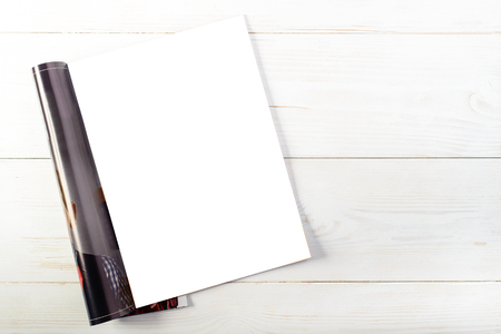 top view of open magazine with blank white pages on light wooden Stock Photo
